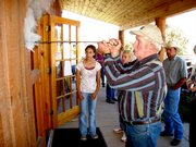 Charles R. Orchard applies his brand to the Summit National Bank during Wednesday's community barbeque celebrating five years of of the bank's business. Ranchers from around the Little Snake River Valley heated irons in the fire and followed suit, welcoming a new ATM and drive-up window to the business.