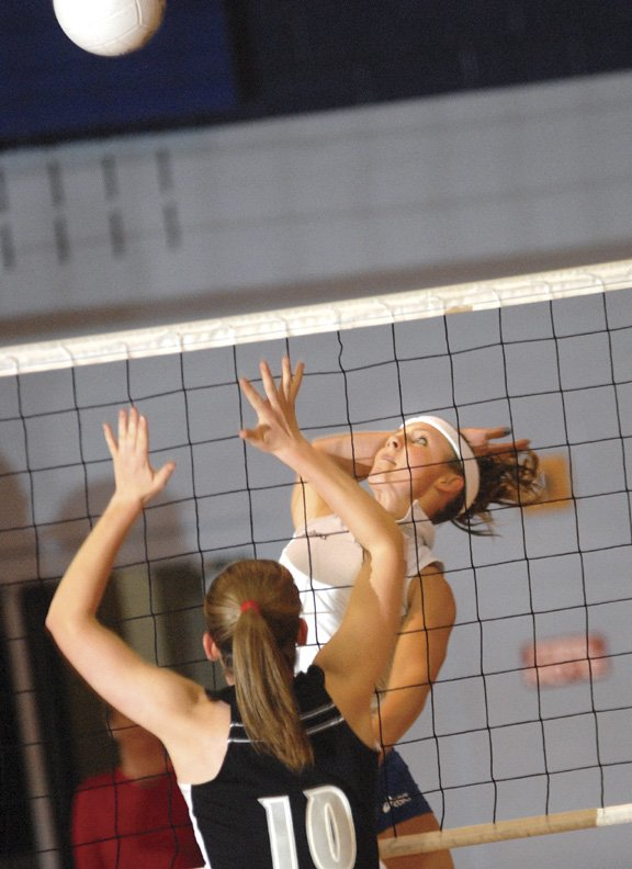 Angie Charchalis of Moffat County spikes the ball in the first set against Meeker High School.