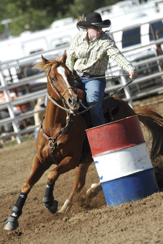 Stevie Brumback, a senior at Moffat County High School, competes in the barrel race during the High School Rodeo at Moffat County fairgrounds Saturday morning. Brumback is riding Drac and finished with a time of 18.358.