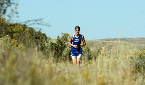 Moffat County High School senior Mike McNicol pushes up the hill on the last half of Saturday's 5,000-meter race at Loudy-Simpson Park during the Bulldogs' lone home meet of the season, the Moffat County Invitational. McNicol placed first in the boys race.