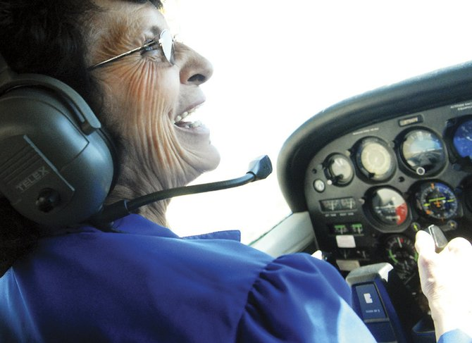 Barbara Jean Sonntag pilots a small airplane under the tutelage of Diane Micci, a Colorado Northwestern Community College flight instructor.  Sonntag created a list of things she wanted to do before leaving this world, and flying an airplane was one of them.