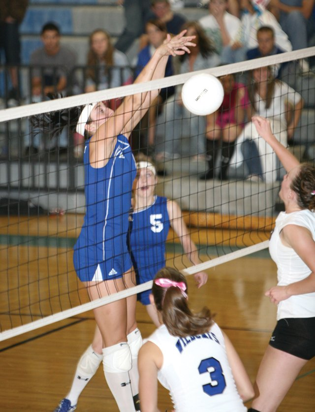 Markie Workman blocks a Palisade spike attempt Monday in Grand Junction. Moffat County rallied for a 20-25, 14-25, 25-20, 25-16, 16-14 victory.