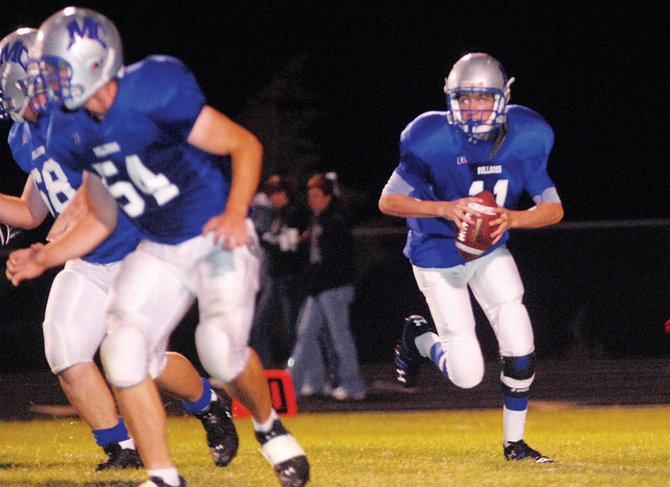 Sophomore Matt Linsacum runs around the left tackle against Berthoud on Friday. The Bulldogs face Delta this week.