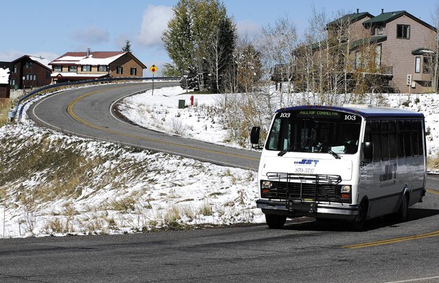 A bus makes its way along Hilltop Parkway on Monday. The Hilltop Connector Route is one of several the city might be forced to cut because of a lack of drivers.