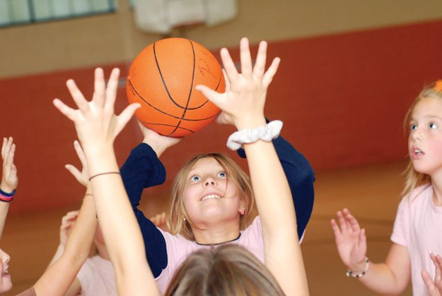Kayla Ford takes a shot over the out-stretched arms of the defense in practice Tuesday at Sunset Elementary School. Ford wants to make it to the WNBA.