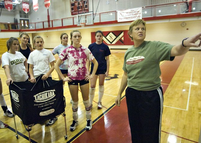 Steamboat Springs High School volleyball head coach Wendy Hall, right, talks strategy with her team during practice in Steamboat Springs on Thursday afternoon.