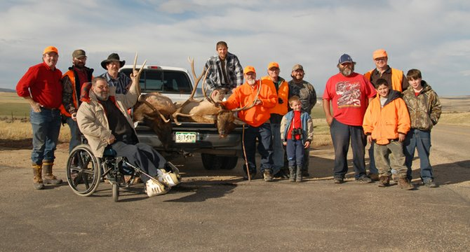 Members of Trapper Mine and the Outdoor Buddies Program pose for a photo after a successful hunt Oct. 20.