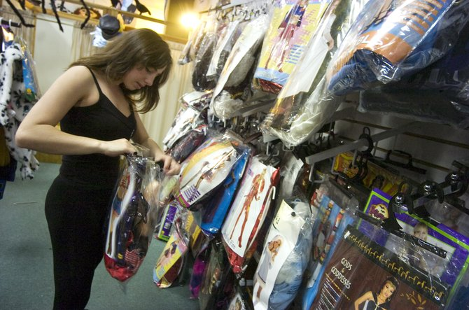 Tanya Boyeva searches for the perfect halloween costume at the Celebrations retail store on the west side of Steamboat Springs on Friday afternoon.