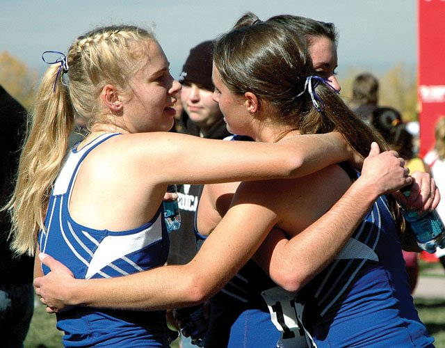 Moffat County junior Laura Zirkle, left, gets in on a group hug with teammates junior Alicia Nelson, foreground, and senior Caitlin Conci after the 2007 Class 4A State  meet in Colorado Springs. The girls finished ninth, led by Nelson's fourth-place finish.