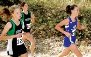 Moffat County freshman Nike Cleverly races in front of two Niwot runners with less than a mile to go at the Class 4A State Cross Country Championships Saturday in Colorado Springs. Cleverly was the team&#39;s third runner and finished in 85th place.