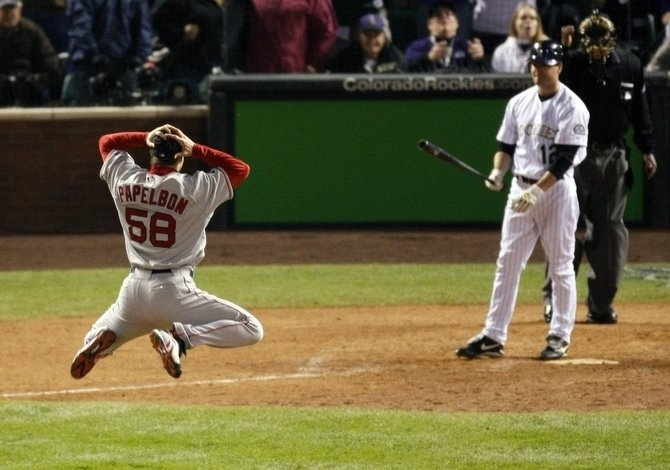 The Boston Red Sox's Jonathan Papelbon celebrates defeating the Colorado Rockies by striking out Seth Smith in Game 4 to win Major League Baseball's World Series in Denver on Sunday.