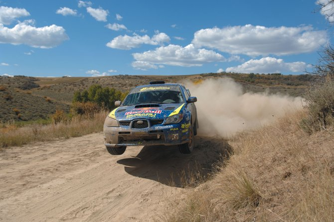 Travis Pastrana and co-driver Christian Edstrom, seen here sliding through turns Sept. 22 at Rally Colorado race stages west of Steamboat Springs, wrapped up the Rally America National Championship with a win at the nine-race series' final event Saturday in Michigan. Pastrana did not defend his 2006 Rally Colorado title. His teammate Ken Block won the local race, former Steamboat Springs resident  Tanner Foust took second and Pastrana took third.