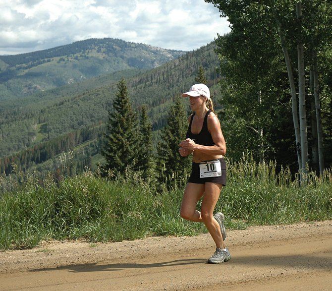 Highlands Ranch resident Marlene Grooms nears the Thunderhead Peak finish of the scenic 12-mile course at the 2007 Mt. Werner Classic. The Mount Werner Classic returns as one of 14 races in the recently announced 2008 running schedule. The series, which was named the state's best series in Colorado Runner Magazine, is starting to receive statewide attention.