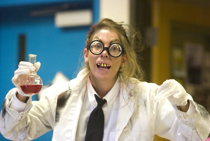 Steamboat Springs Middle School science teacher Lisa Lorenz shows off her mad scientist costume as she prepares to do a lab exercise with her class Wednesday.