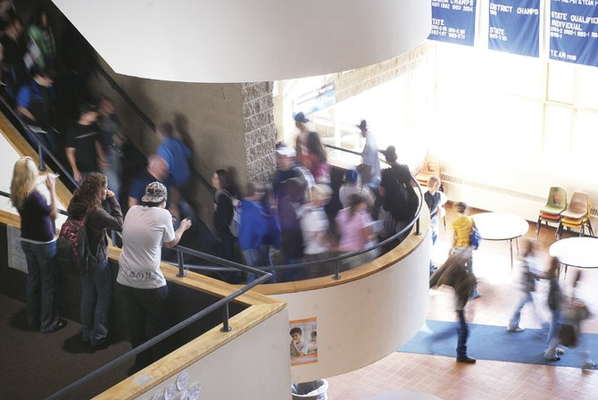 A stream of students fills the main staircase at Moffat County High School. On Monday, the Parent Accountability Committee is scheduled to meet, allowing parents and school officials to discuss issues pertinent to parents and students.