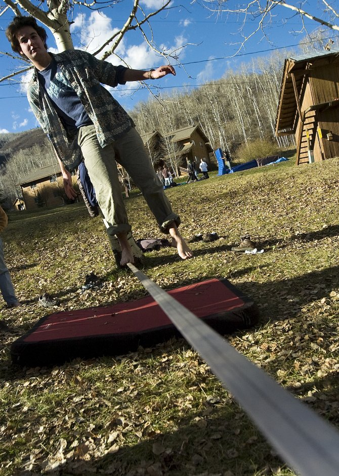 Brady Findell practices walking the slack line at the Lowell Whiteman School outside Steamboat Springs on Thursday, Nov. 1, 2007.