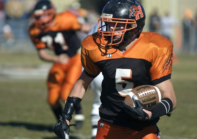 Hayden's Coy Letlow dashes downfield during the first half of the Tigers' game in Hayden on Saturday. Letlow had 180 rushing yards on the day as Hayden won the first-round playoff game, 35-27.
