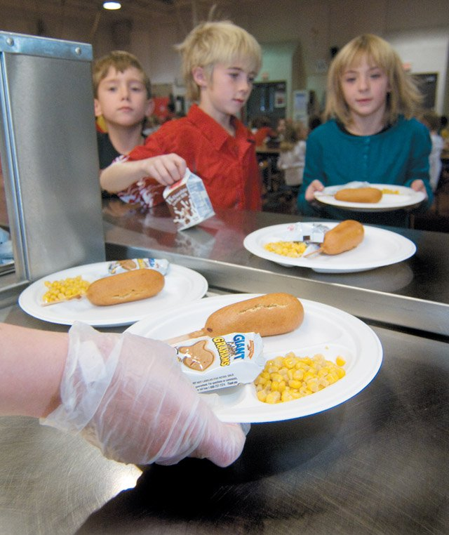 "Elementary school students don't seem to notice the biodegradable plates their food is on as they make their way through the lunch line at Strawberry Park Elementary School on Monday. Yampa Valley Recycles, a nonprofit organization, will recognize the student-led recycling effort and the school's ""Green approach"" at the Nov. 13 Steamboat Springs City Council meeting."