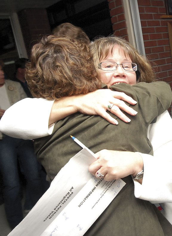 "Gail Severson, left, The Memorial Hospital foundation member, hugs Corrie Ponikvar, who is on the TMH Board of Trustees, at the Moffat County Court House after finding out Referendum 1A passed in Tuesday's election. Referendum 1A - a $42.6 million tax question that would pay for the construction of a new hospital - earned 57 percent of the ""yes"" votes. Referendum 3A - a $29.5 million School District initiative to fund a new Craig Middle School and renovations to all district campuses - garnered 64 percent of the ""yes"" votes."