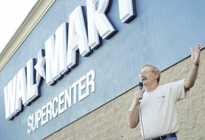 Craig Mayor Don Jones gives a brief speech as part of Wal-Mart's Grand Opening on Wednesday morning in Craig. The ceremonies included speeches by Wal-Mart management, a presentation of the flag by the VFW, and a performance by the Moffat County High School band.