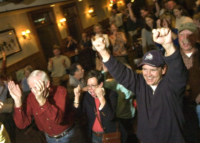 Tony Connell, right, Paula Cooper Black, center, and Ron Roundtree cheer as election results are announced Tuesday night at Old Town Pub & Restaurant in downtown Steamboat Springs. The restaurant and bar served as election night headquarters for City Council candidates Cari Hermacinski, Jon Quinn, Scott Myller, Walter Magill and Paul Hughes. Hermacinski, Quinn, Myller and Magill won convincing victories, immediately swinging the balance of the council.