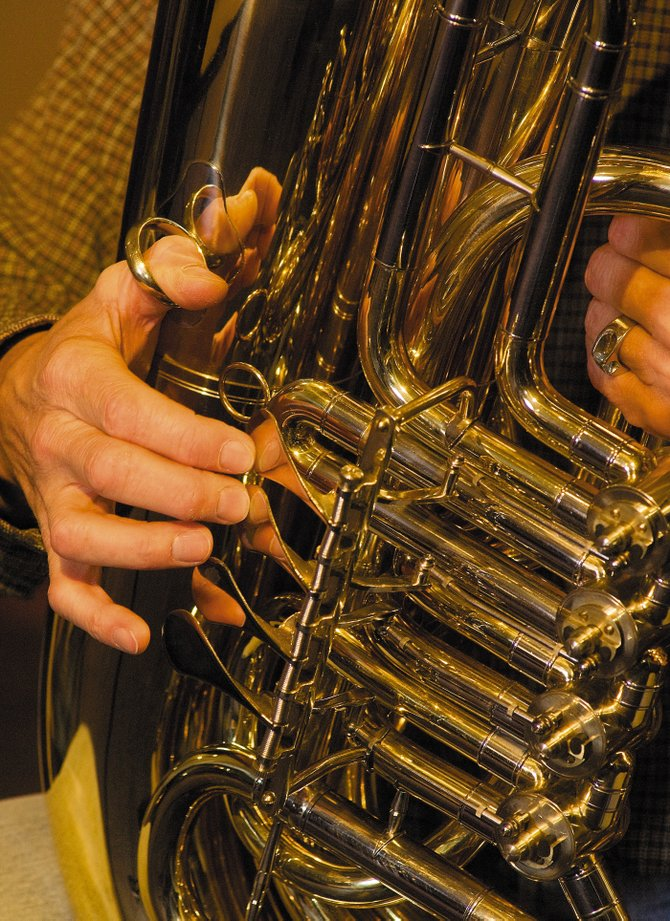 The shiny finish of Walt Seabert's tuba will be combined with the rich brass sound of the Emerald Cith Opera's Resident Artist Spotlight Series at 7 p.m. this Friday night at the United Methodist Church.