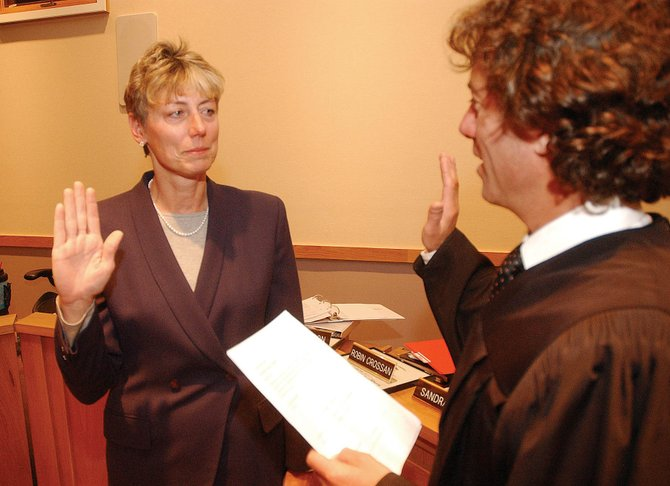 Steamboat Springs School Board District 4 representative Robin Crossan is sworn in Monday night by Steamboat Municipal Court Judge Paul Sachs. Crossan was subsequently appointed board president, replacing Denise Connelly.