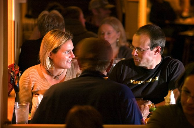 Peter Sloop, right, and his wife, Heather, enjoy a conversation while eating dinner at The Rio Grande restaurant in downtown Steamboat Springs on Friday night.