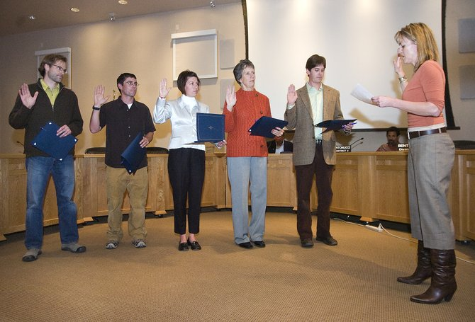 Newly elected members of the Steamboat Springs City Council are sworn in during Tuesday night's meeting at Centennial Hall. From left, Scott Myller, Walter Magill, Cari Hermacinski, Meg Bentley and Jon Quinn take the oath of office administered by Steamboat Springs City Clerk Julie Jordan.