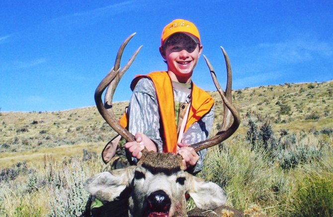 Garrett Stewart shows off the fruits of his hunting labor. Stewart shot and killed his first deer this year at the ripe old age of 12.
