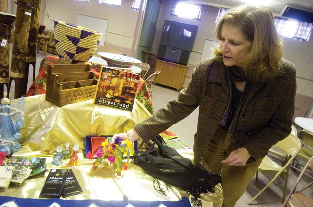 Julie Alkema shows off a variety of decorations on display at the Holy Name Catholic Church in Steamboat Springs which will be sold Saturday and Sunday at the 10th annual Work of Human Hands craft bazaar.