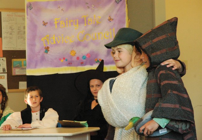 "Lowell Whiteman Primary School students Noah Bass and Max Sauerbrey perform a scene from ""Character Matters"" on Wednesday. Bass, who played Jack, and Sauerbrey, who played the Giant, perform a scene inspired by the ""Jack and the Beanstalk"" fairy tale to emphasize that first impressions are not always correct."