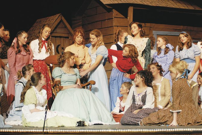 "The cast of ""Oklahoma!"" sings ""Out of My Dreams"" Thursday night at the Moffat County High School auditorium."