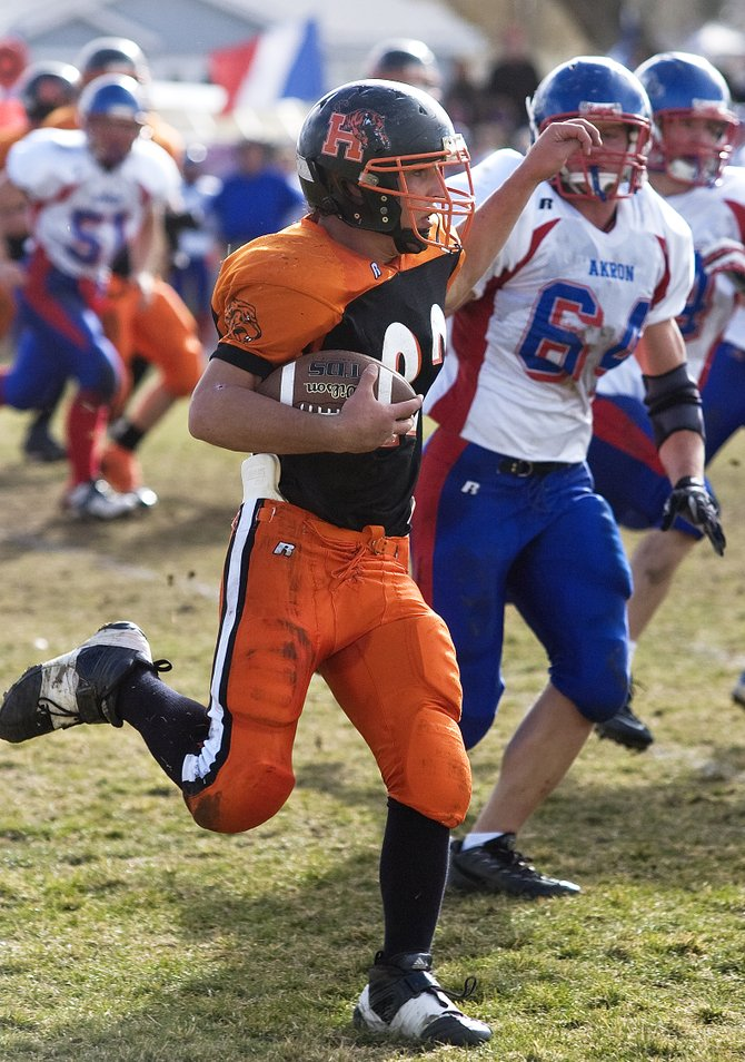 Hayden's Russel Waugh gains extra rushing yardage during the Tigers' semifinal playoff game against Akron in Hayden on Saturday afternoon.  The Tigers were defeated, 55-6.