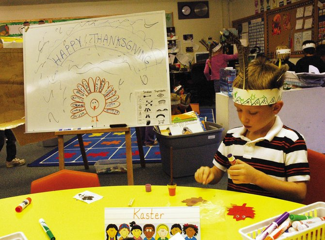 Steamboat Springs kindergarten student Kevin Kaster focuses on his Thanksgiving-themed arts and crafts project Tuesday. Students have used the month leading up to Thanksgiving to learn about diversity, and Tuesday culminated with a feast of sliced apples, pumpkin bread and popcorn.