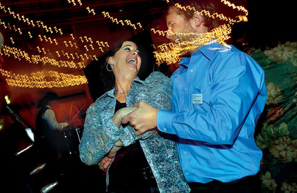 Terri Jourgensen, left, dances with former Boys & Girls Club of Craig executive director Jonathan Godes at last year's Cowboy Christmas. This year's event is Dec. 1 at the club, 1324 E. Highway.