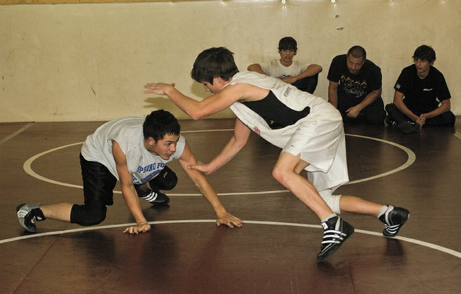 Soroco High School senior Levi Gonzales, left, and Justin Iacovetto spar in the high school&#39;s weight room last week during practice. Gonzales is working hard this season with hopes of returning to the state high school championships at Denver&#39;s Pepsi Center and for another shot at winning a state title.