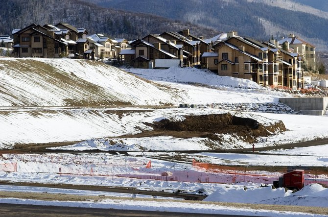 The construction sites at the Trailhead Lodge and Wildhorse Meadows developments sit idle Friday afternoon. Recently released real estate figures mark a new record high for annual sales in Routt County.