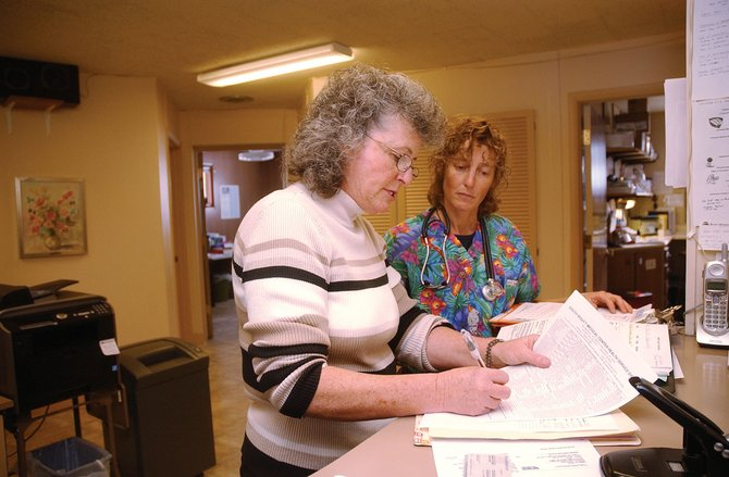 Receptionist Kathy Reed, front, and registered nurse Melissa Uchitelle-Rogers work Wednesday at the South Routt Medical Center.  The medical center is expected to be open five days a week starting Jan. 1.