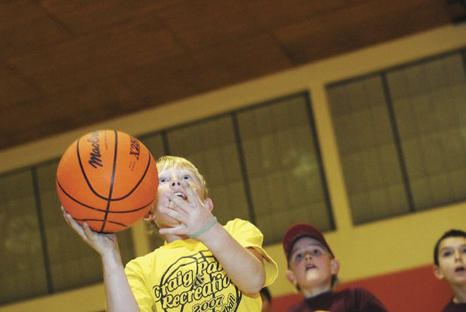 Cutter Barnes, 9, shoots at the basket Tuesday night in the Sunset Elementary gymnasium. Barnes is on one of Craig Recreational Third- and Fourth-grade Youth Basketball teams that play Tuesday and Thursday nights.