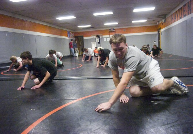 Coy Letlow, right, practices with his wrestling teammates at Hayden High School on Tuesday. The Tigers will open their season this Saturday at the Middle Park Invitational.