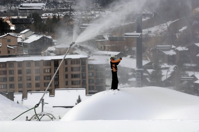 It's time for a temperature reading as crews continue to pour on the snow near the Christie Peak Express mid station Monday. The new chairlift underwent a second load test Tuesday.