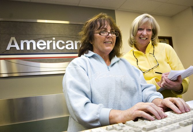 Dorothy Goodwin, left, and Lindsay Giessinger get some extra training on the American Airlines customer ticketing and check-in system at the Yampa Valley Regional Airport in Hayden on Tuesday afternoon.