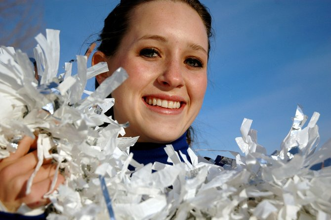 Moffat County cheer team captain Cassie Rogers holds on to her pom-poms while posing for a photo Thursday. The Bulldogs travel today to Denver for the state championships.