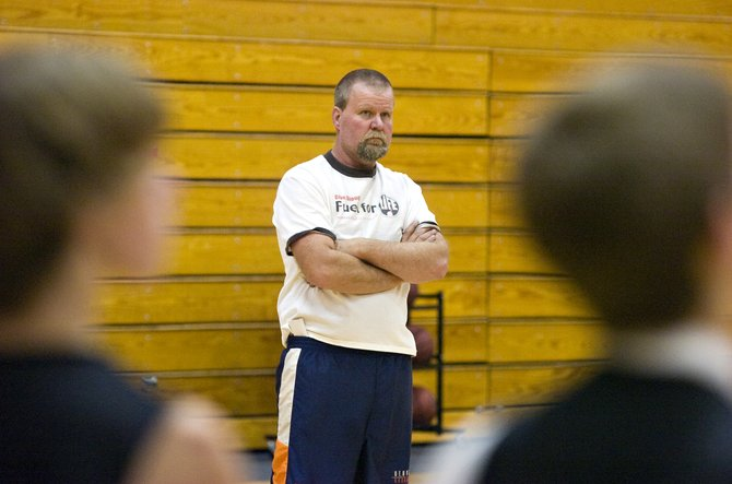 Robin Lighthizer, shown here at practice in Hayden on Wednesday afternoon, was the assistant coach of the Tigers boys basketball team. This season, he has stepped up into the role of head coach.