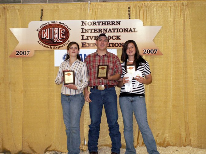 Northern International Livestock Exposition winners, from left, Morgan Hatfield, Ian Fralick and Catharine Koroulis show off their awards after finishing first as a team in the Montana competition.