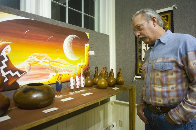 Bruce Roemmich glances at a series of Navajo pottery items on display at the Depot Art Center in Steamboat Springs on Friday.