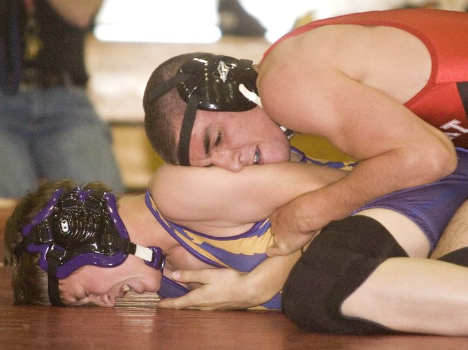 Steamboat Springs High School wrestler Houston Mader, top, tries to pin Ryley Giacometto from Saratoga, Wyo., during the Carl Ramunno Invitational in Steamboat Springs on Saturday morning. Mader went on to win first place in the 140/145-pound division.