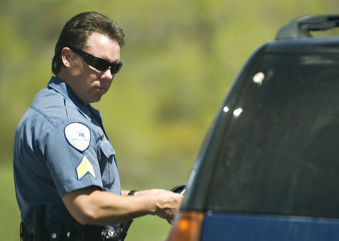 Steamboat Springs Police Sgt. Nick Bosick makes a traffic stop on Hilltop Parkway on May 11. Bosick will fill the detective position recently vacated by Matt Harmon, who has taken a position with the District Attorney's Office.