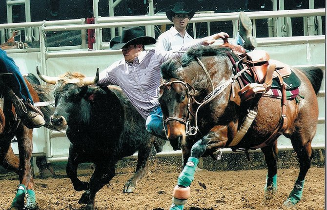 Craig resident Casey McMillen displays the skills needed in his line of work. As a professional cowboy, McMillen has earned more than $80,000 this season. He will look to more than double that payoff throughout the week in the National Finals Rodeo in Las Vegas. The finals air on ESPN2 all week.